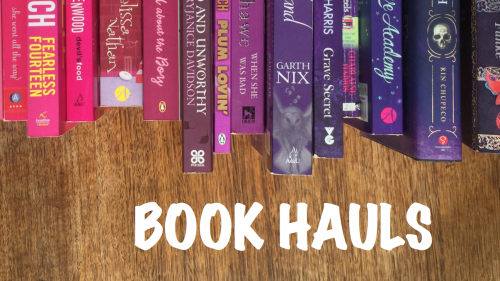 Book haul banner with a rainbow of pink and purple book spines