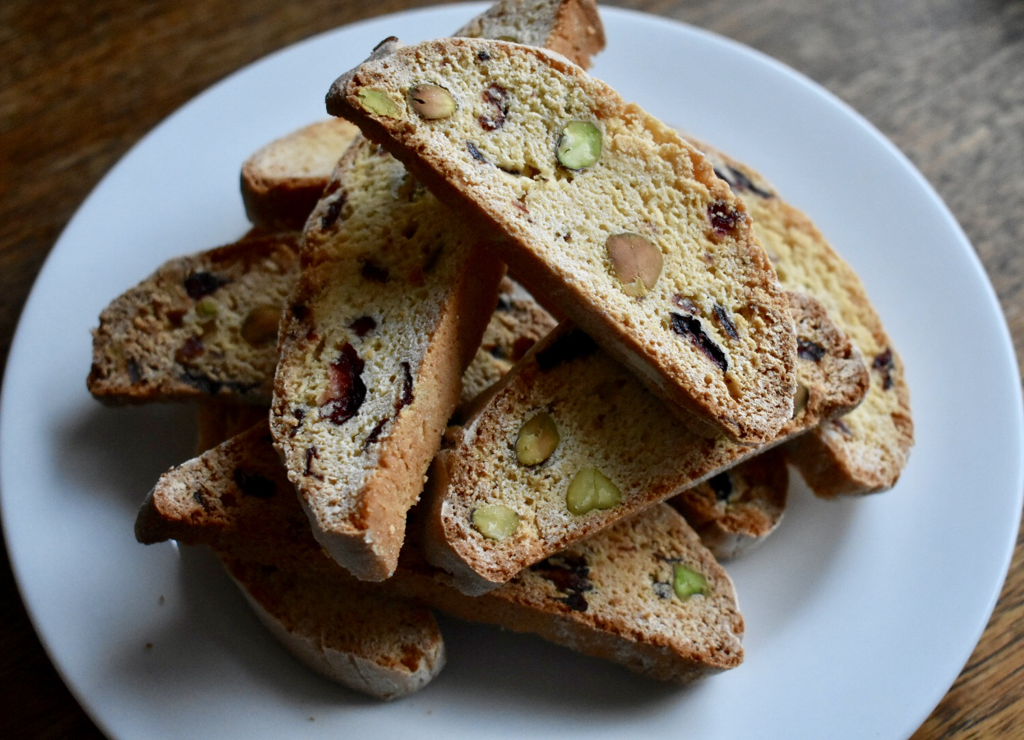 Photo of cranberry and pistachio biscotti pieces stacked on a place