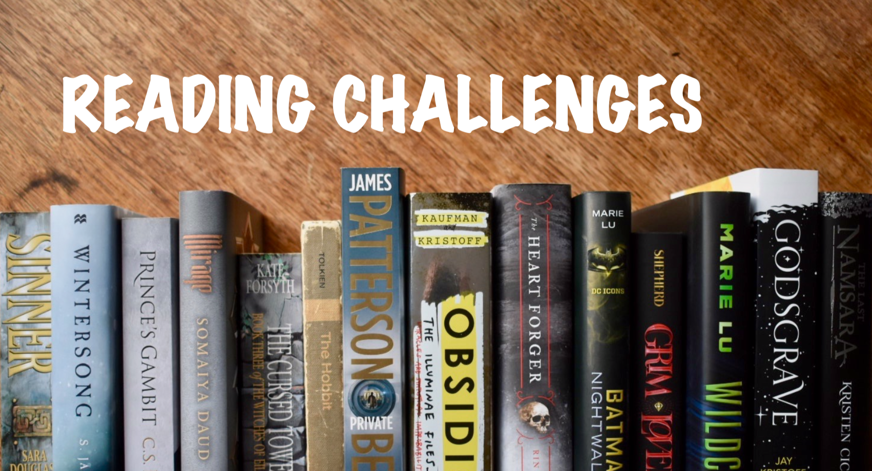 Reading challenge banner with grey and black book spines