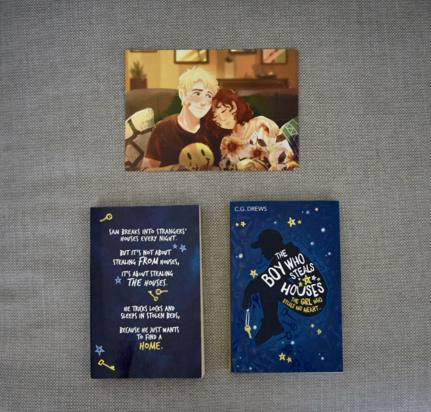 ARC and finished copy of The Boy Who Steals Houses with the art print of Sam and Moxie