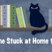 Banner: The Stuck at Home tag. Drawing of a bookshelf in the background with a black cat sitting on it.