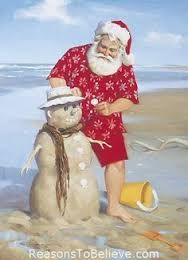 A photo of Santa wearing a red hawaiian shirt, red shorts and a santa hat. He is at the beach building a snowman out of sand.